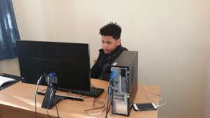 Young people learning on Computer