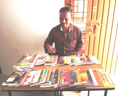 New Life's staff with the books