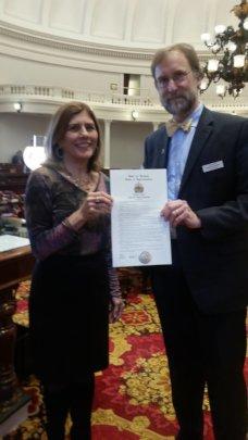 JoEllen Tarallo of CHL, receives the Resolution