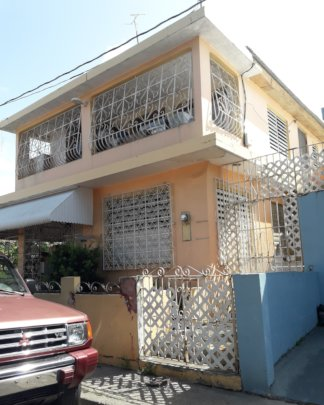 Jose's Newly Roofed Home, Exterior Side View