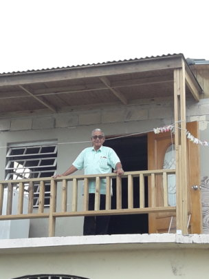 Don Cosme in His Newly Roofed Porch