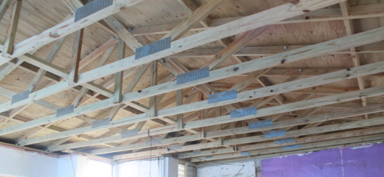 Close-up Yolanda's finished, resilient roof
