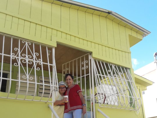 Nilda in front of her newly built roof