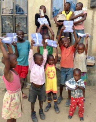 Happy children receiving supplies