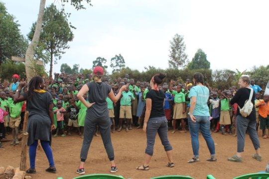 Visitors teaching kids song