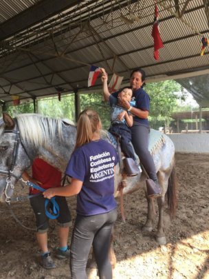 Ismael riding with Veronica