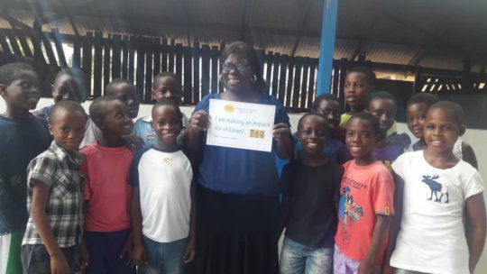 """Meyah, Ghana - with our """"impact"""" sign"""