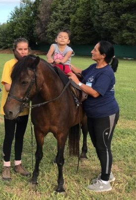 Briana at a horse-assisted therapy session