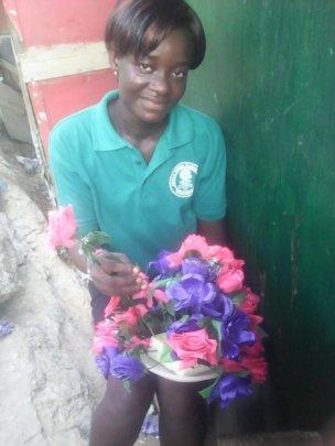 Dora learning to make a flower arrangement