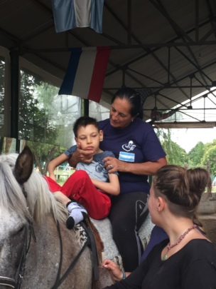 Ismael riding with Veronica on Cafe, the horse