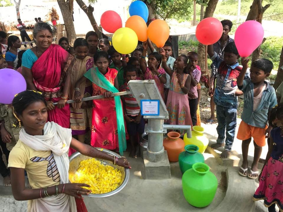 Villagers celebrating their water well