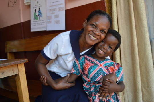 Sister Florence, a nurse at AMS, hugs little Lucy