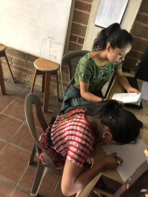 Chonita works with Lourdes on her math skills