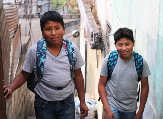 Diego, 13, and David, 14, head off to school!