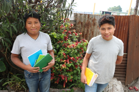 Diego and David showing off new school supplies
