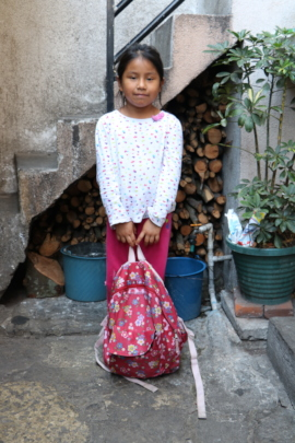 Damariz's 1st year of school, with a big backpack