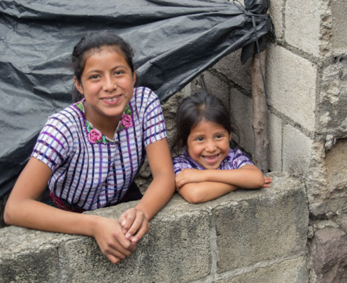 Dolores stands next to her older sister Pascuala