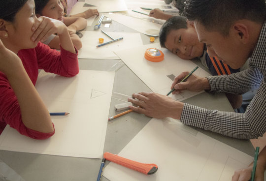 Diego sneaks a smile during our art workshop