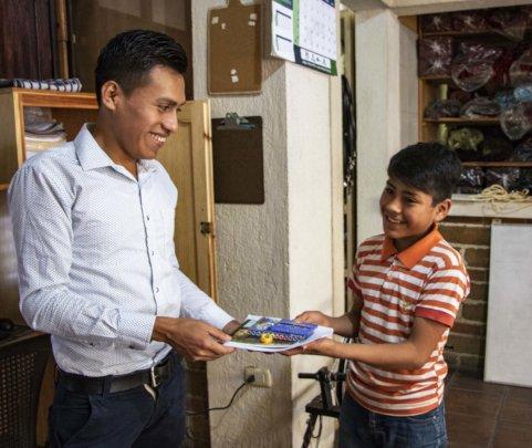 Jose our Program Director gives Manuel supplies