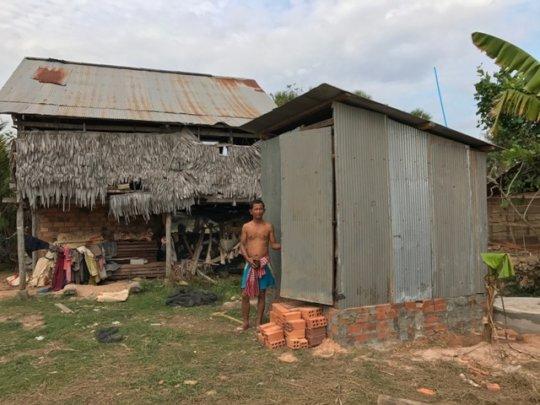 Improved latrine building