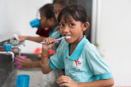 Students brushing their teeth after lunch at ISF