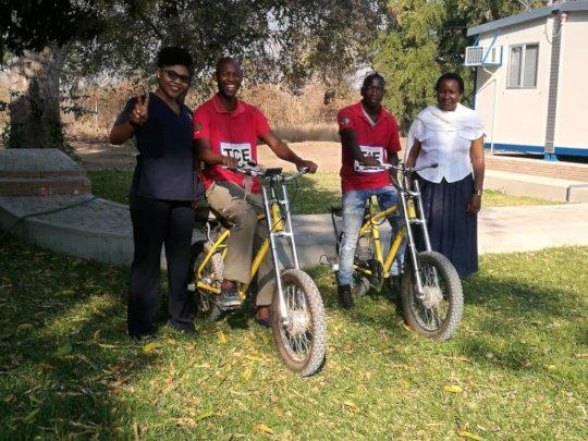 Sister Lumba Maswahu with fellow nurse and CACs.