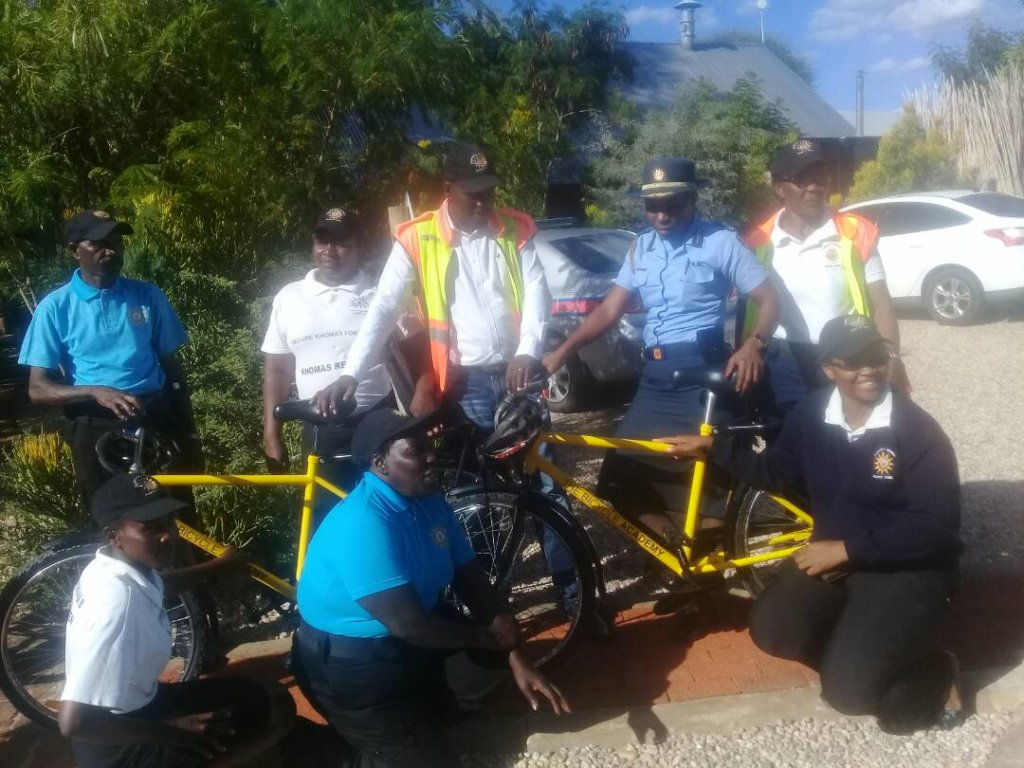 Neighbourhood watch volunteers receiving bicycles