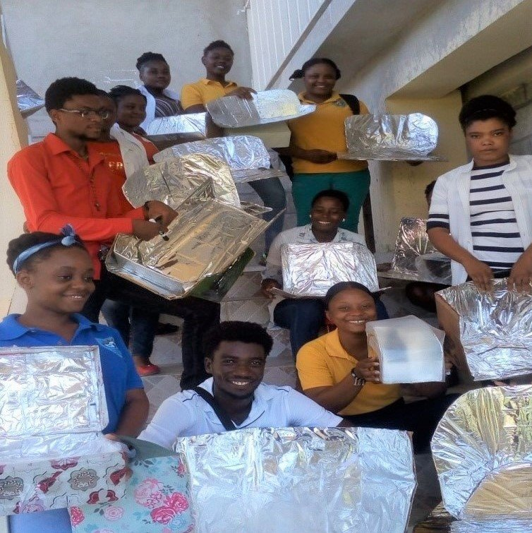 Group with their homework solar cookers