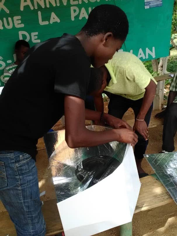 A new solar cooker at university in Hinche, Haiti