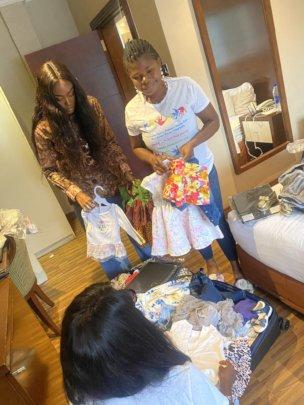 VSCWC staff getting preloved children's wear ready