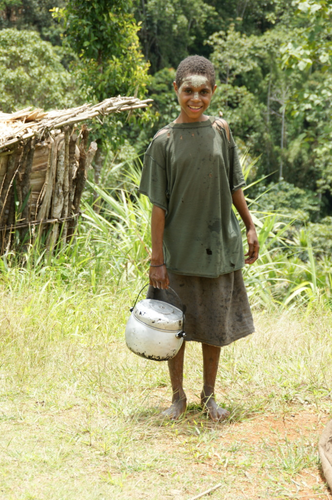A Suowi Ankave girl gathering water for cooking