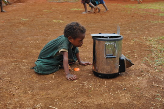 A Suowi Ankave child inspects the new tech in town