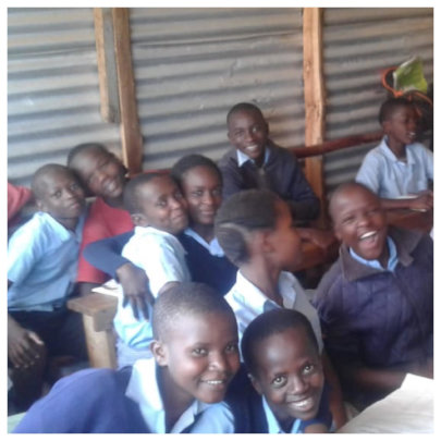 6th graders pause during Kiswahili class