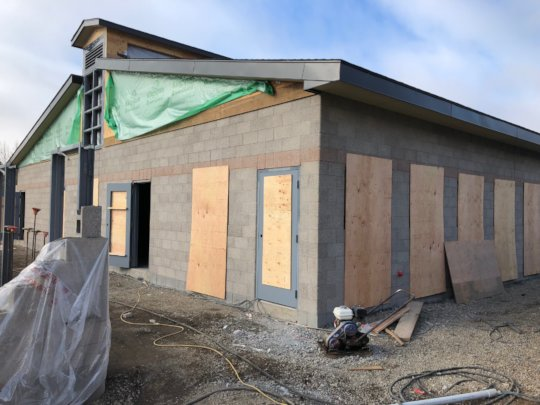 Walls and roof are up on the first building