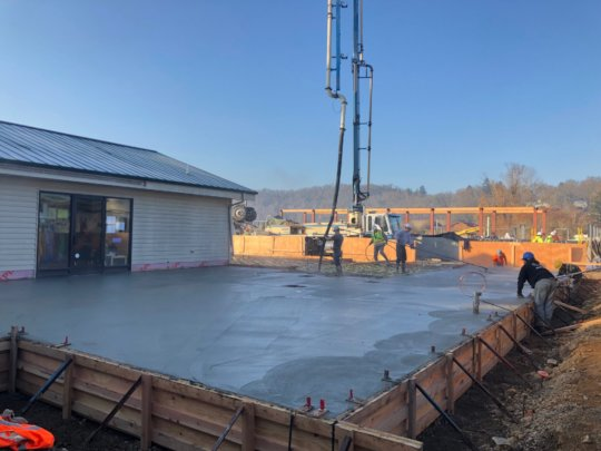Concrete gets poured for the central building