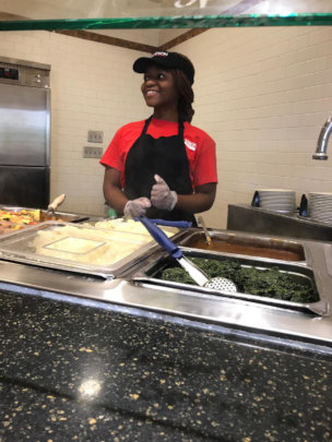 Kim at her dining hall job at Davidson College