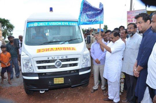 Deputy CM Dr. G Parameshhwara flagging  ambulance