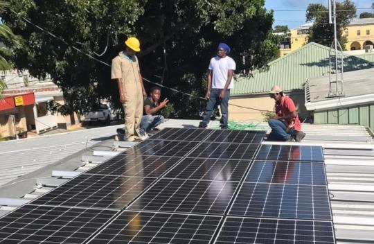 Solar Graduates Install System on Community Center