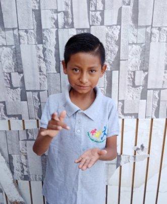 "Angelito saying ""Gracias"" in sign language"