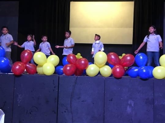 Children Peforming On Stage