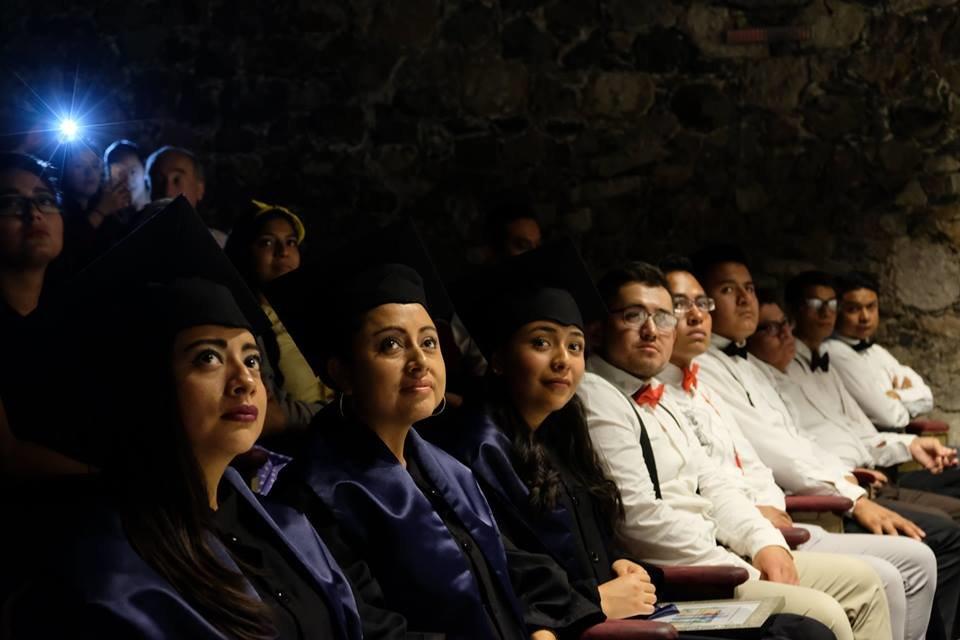 Grads and Fellow Students Watch Translator