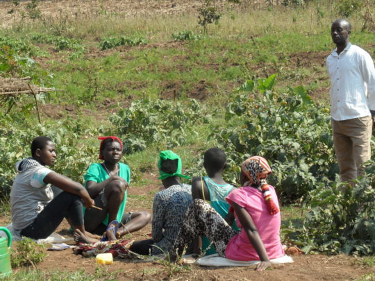 Agronomist with the trainers-teen mothers