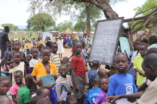 Children at a makeshift school in Palorinya