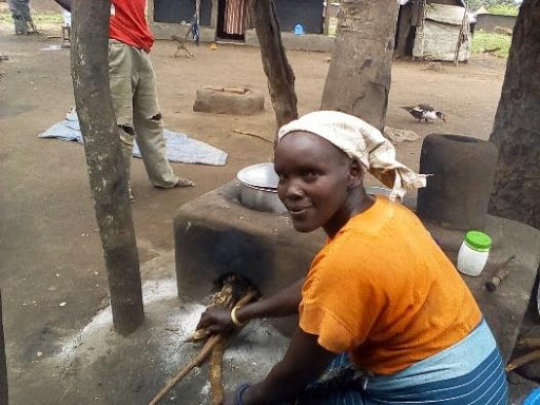 Refugee mother with her new eco-cookstove