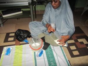 Zainab making yogurt