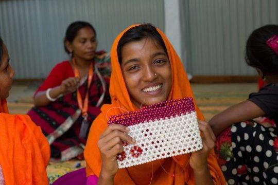 Kohinur, 14, who is learning Burmese and English