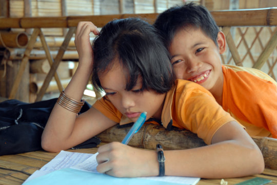 Children completing schoolwork in Thailand