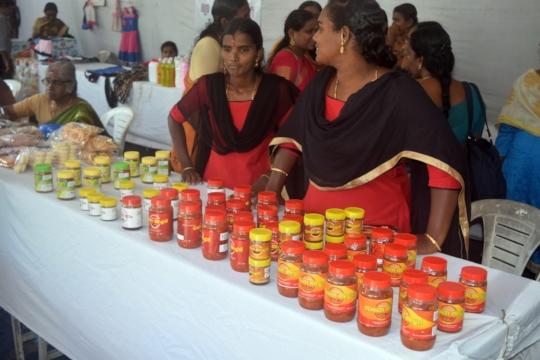 Women selling products - putharikandam Trade fair