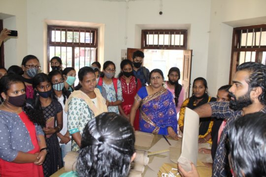 women acquiring training for paper pouches