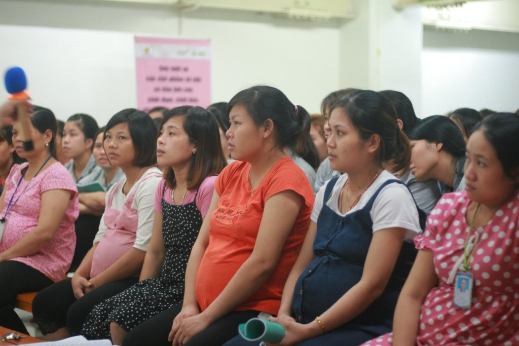 Pregnant worker at a communications session